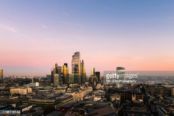 elevated view of london's skyline with the shard tower at sunset - tim grist stock pictures, royalty-free photos & images