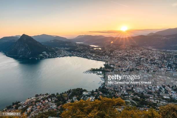 elevated view of lugano and lake lugano at dusk - スイス ルガーノ ストックフォトと画像