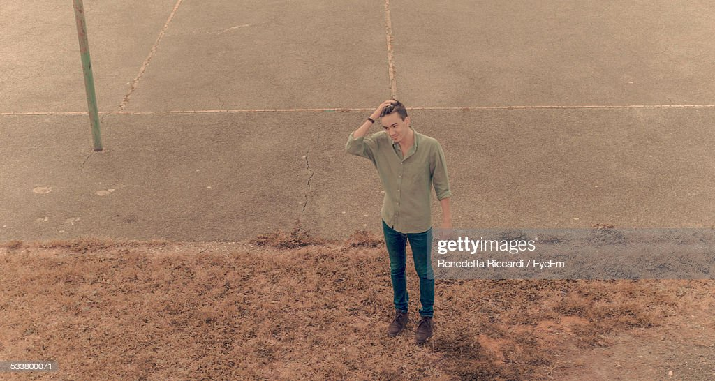 Elevated View Of Man Standing Next To Concrete Playing Field : Foto stock