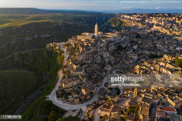 elevated view of matera at sunrise - jeremy woodhouse stock pictures, royalty-free photos & images