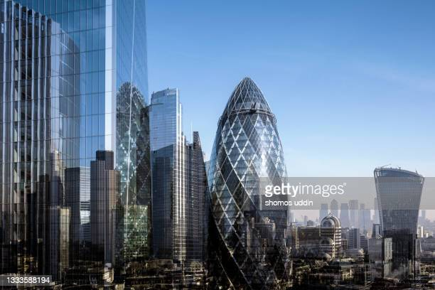 elevated view of modern london skyscrapers - multiple exposure - london stock pictures, royalty-free photos & images
