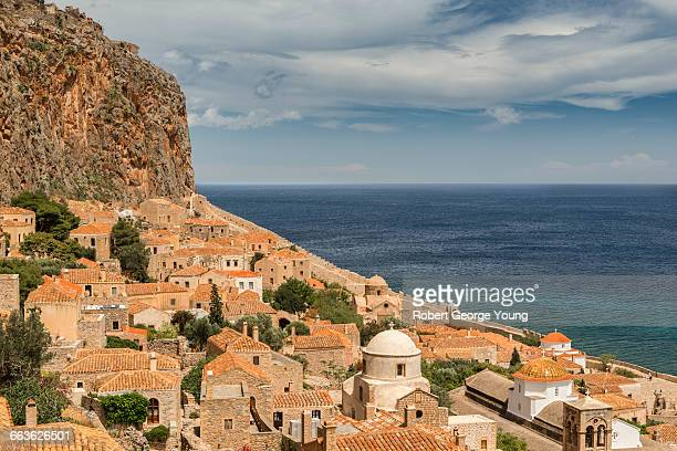 elevated view of monemvasia, castle & domed church - monemvasia - fotografias e filmes do acervo