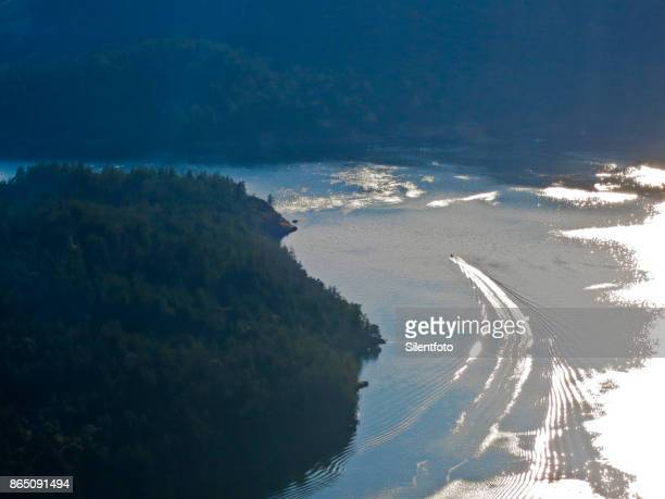 Elevated View of Motor Boat Cruising BC Coastline