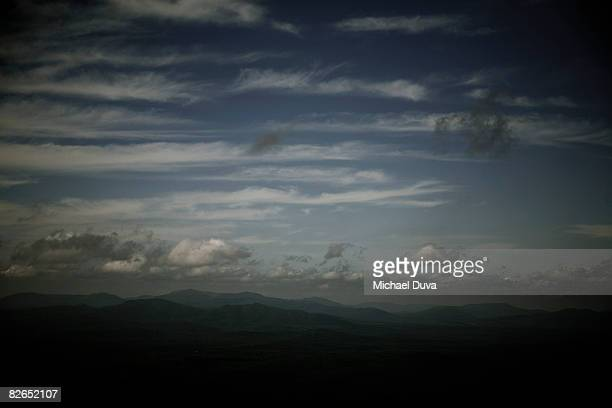 elevated view of mountain range and clouds