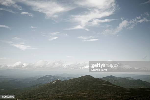 elevated view of mountains and clouds