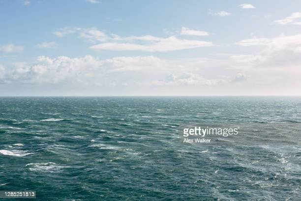 elevated view of open ocean with small waves. - wind stock pictures, royalty-free photos & images
