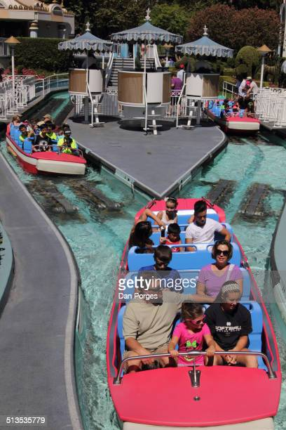Elevated view of people in boats on the 'It's a Small World' amusement park ride at Disneyland Anaheim California July 23 2014