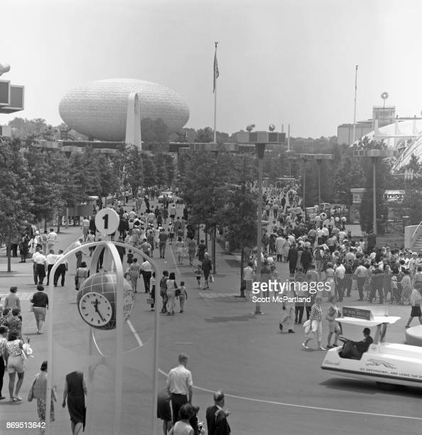 Elevated view of people walking along the paths and taking in the sights at the 196465 World's Fair in Flushing Meadows Corona Park New York New York...