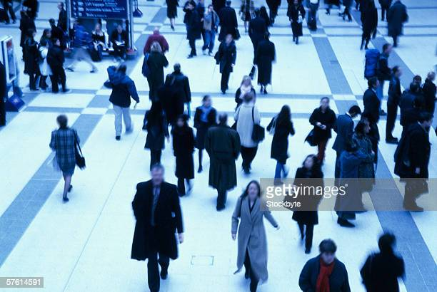 Elevated view of people walking in a building