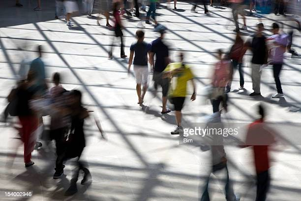 Elevated View of People Walking Through Hallway