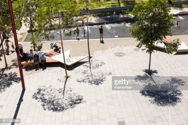 elevated view of playground with families and children, copy space - darling harbour stock pictures, royalty-free photos & images