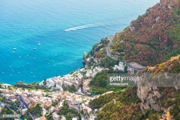 elevated view of positano village and coastline. positano, amalfi coast, salerno, italy - amalfi coast stock photos and pictures