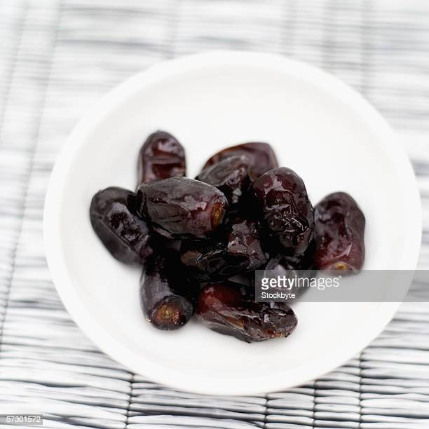 Elevated view of prunes in a bowl