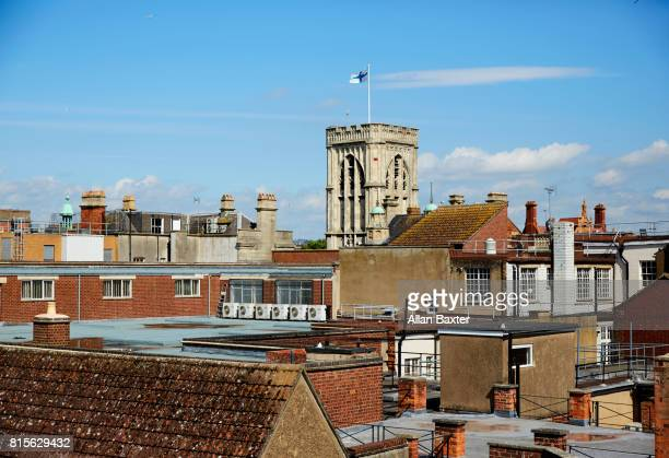 Elevated view of rooftops in Gloucester under blue skies