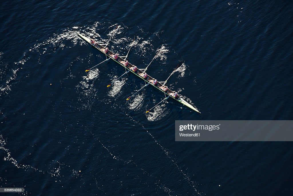 Elevated view of rowing eight in water