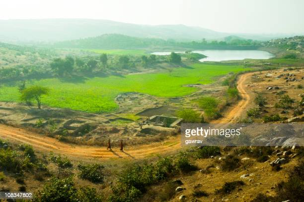 elevated view of rural landscape, farm, road and pond - madhya pradesh stock photos and pictures