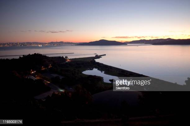elevated  view of san francisco bay in warm evening light - east bay regional park stock pictures, royalty-free photos & images