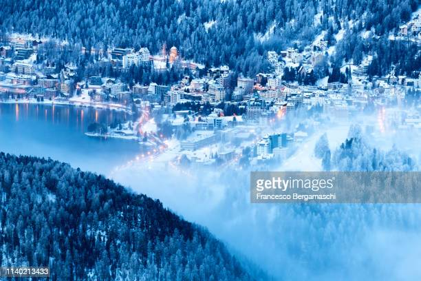 Elevated view of Sankt Moritz at dusk. Engadine valley, Canton of Grisons, Switzerland, Europe.