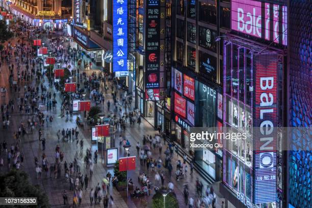 elevated view of shanghai nanjing road at night - nanjing road stock pictures, royalty-free photos & images