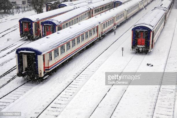 elevated view of snow covered train station and railroad in istanbul - haydarpasa stock photos and pictures