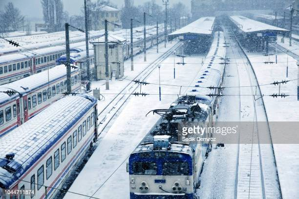 elevated view of snow covered train station - haydarpasa stock photos and pictures