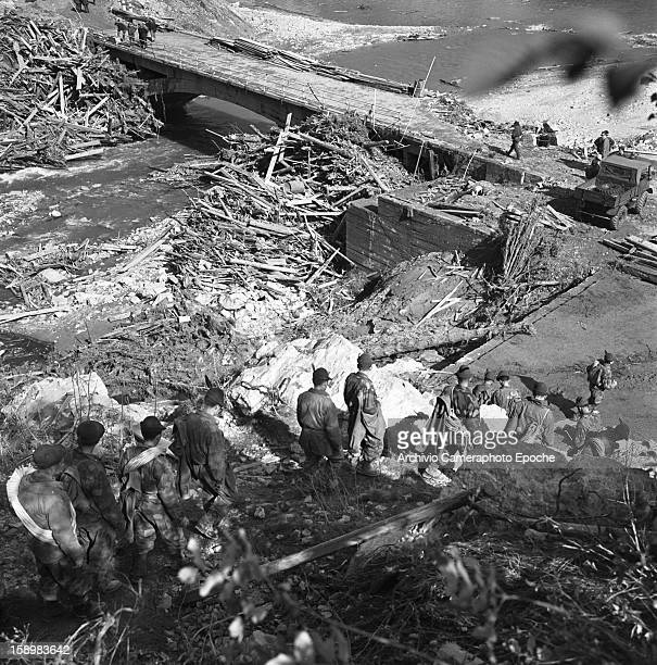 Elevated view of soldiers as they clear rubble from a bridge near the Vajont Dam Longarone Piave Valley Italy early October 1963 On October 9 a...