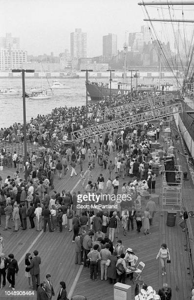 Elevated view of spectators at Lower Manhattan's South Street Seaport during the Brooklyn Bridge's 100th birthday celebrations New York New York May...