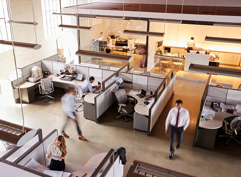 Elevated view of staff working in a busy open plan office 1011792700