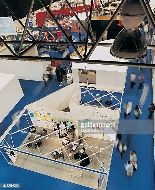elevated view of stalls at a business exhibition - tradeshow stock pictures, royalty-free photos & images