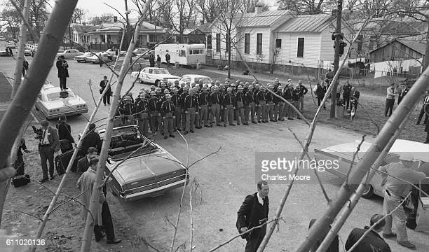 Elevated view of state troopers armed with billy clubs as they wait, near the Edmund Pettus Bridge, for marchers on the first Selma to Montgomery...