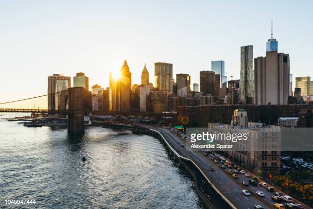 Elevated view of sunbeam shining through skyscrapers in Manhattan Financial district, New York City, USA