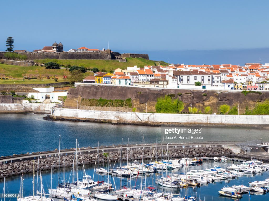 Elevated view of the city, harbor and castle of Angra do Heroismo, a UNESCO World Heritage Site, on Terceira Island in the Azores, Portugal. : Stock-Foto