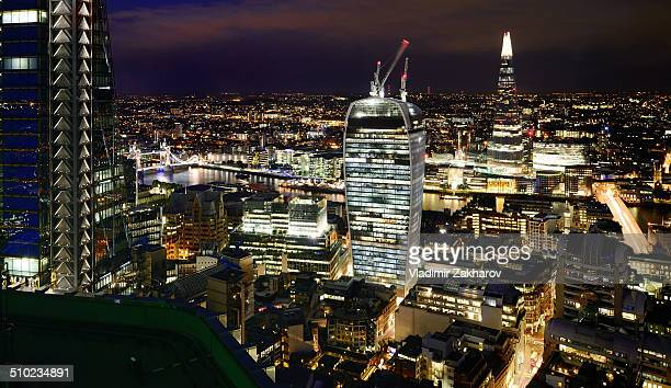 Elevated view of The City, London's financial centre including all brand new skyscrapers and Tower Bridge at night.