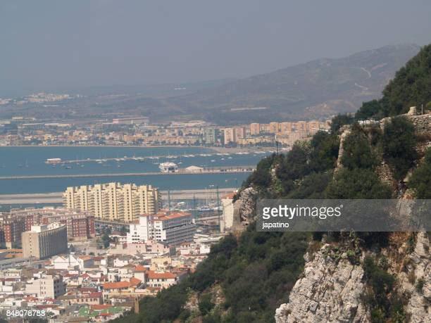 elevated view of the city of gibraltar (uk) in the foreground and the line of concepcion (cadiz, spain) in the background - la linea de conception stock pictures, royalty-free photos & images