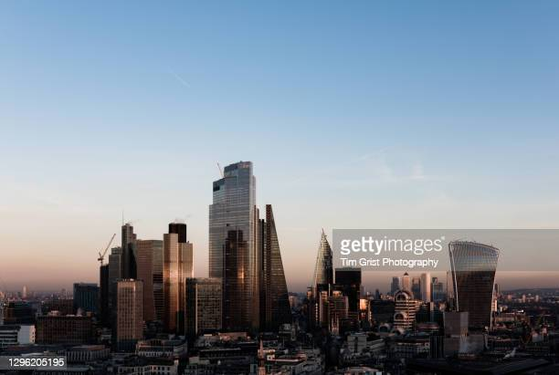 elevated view of the city of london skyline at sunset - clear sky stock pictures, royalty-free photos & images