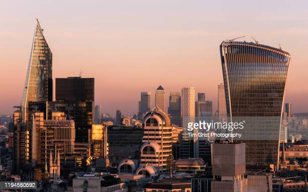 elevated view of the city of london's financial district skyline at sunset - tim grist stock pictures, royalty-free photos & images