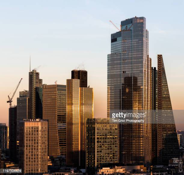 elevated view of the city of london's financial district skyline at dusk - tim grist stock pictures, royalty-free photos & images