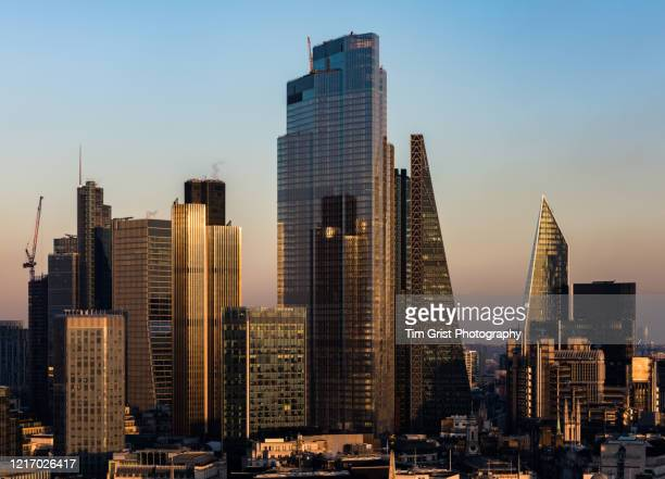 elevated view of the city of london's financial district skyline - corona landmarks stock pictures, royalty-free photos & images