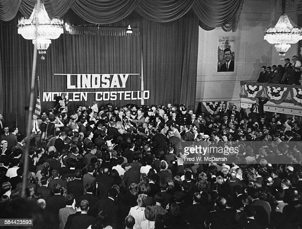 Elevated view of the crowded ballroom as American politician John V Lindsay speaks to the press on election night after his mayoral victory 1965 He...