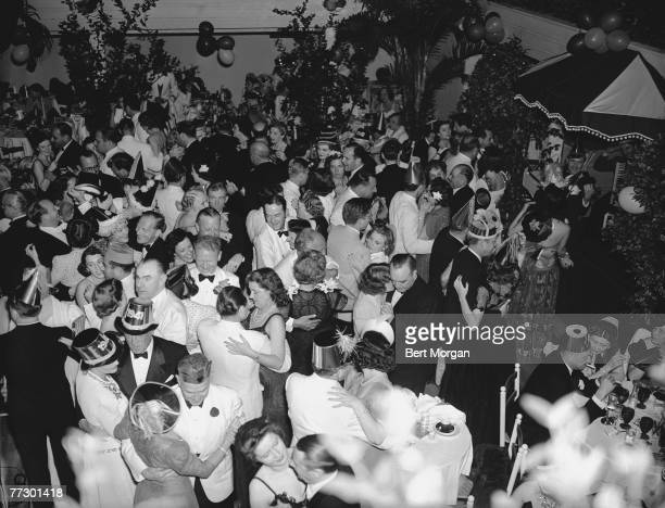 Elevated view of the dance floor at The Patio where welldressed couples dance at a New Year's Eve party Palm Beach Florida December 31 1940
