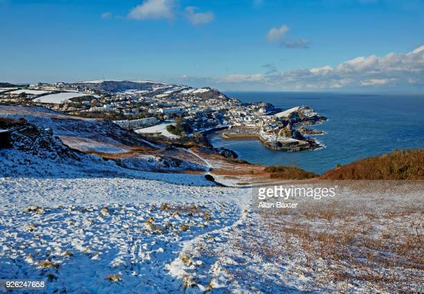 elevated view of the fishing village of ilfracombe after snow - イングランド南西部 ストックフォトと画像
