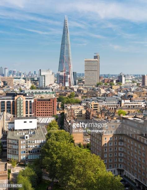 elevated view of the london skyline across southwark towards the shard tower and canary wharf. - isle of dogs london stock pictures, royalty-free photos & images