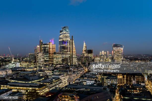 elevated view of the london skyline at night - business finance and industry stock pictures, royalty-free photos & images