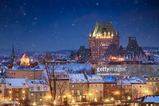 elevated view of the quebec city skyline at night on a snowy winter night - quebec stock pictures, royalty-free photos & images