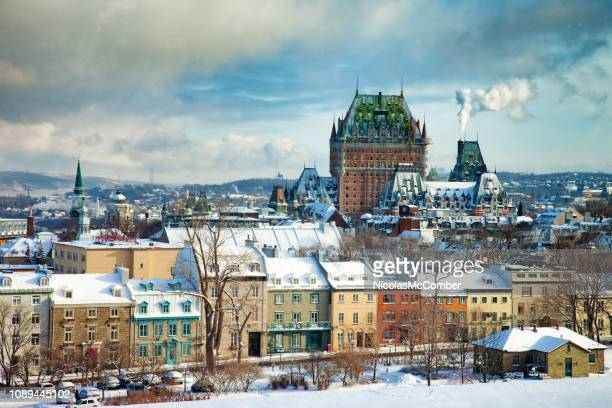 elevated view of the quebec city skyline during partially sunny winter day - quebec city stock pictures, royalty-free photos & images