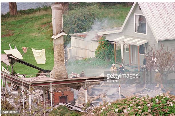 Emergency services personnel in the ruins of the Seascape Guesthouse where gunman Martin Bryant retreated after shooting and killing 35 people during...