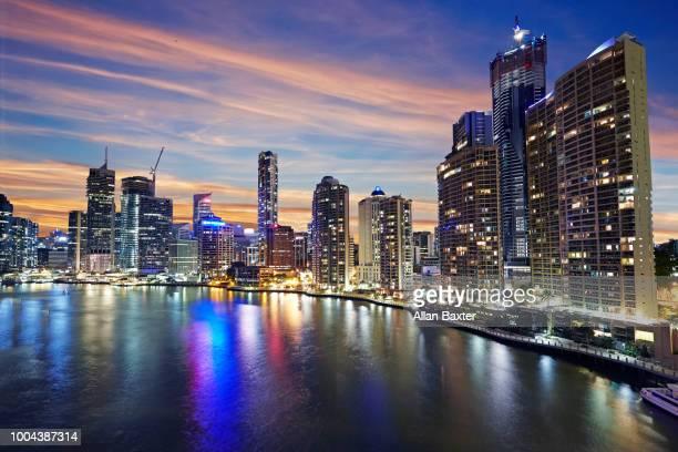 Elevated view of the skyline of Brisbane illuminated at dusk