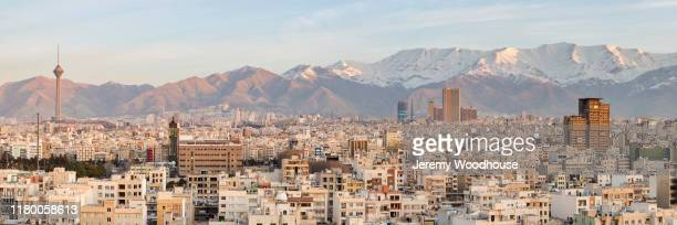 elevated view of the skyline of iran looking south towards the alborz mountains at sunrise - tehran stock pictures, royalty-free photos & images