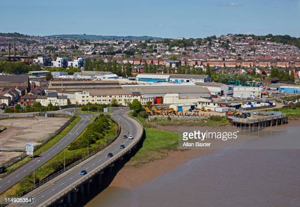 elevated view of the skyline of newport with river usk - newport wales stock pictures, royalty-free photos & images
