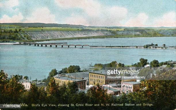 Elevated view of the St Croix River Northwest Railroad bridge and part of the town of Hudson Hudson Wisconsin 1915